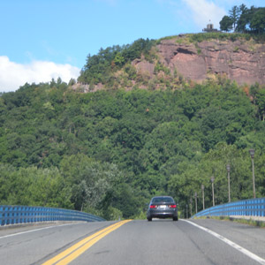 Car driving on road with mountain in the bg