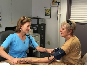 Nurse Lisa White takes a blood pressure reading at the Deerfield clinic.