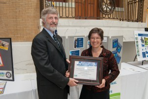 FRCOG receives a Toxics Use Reduction Chamption Award at the State House. Director of Community Services Phoebe Walker accepted the award from TURI Director Michael Ellenbecker.