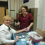 Representative Denise Andrews getting her flu shot at a CPHS flu clinic at Gill Elementary School last fall