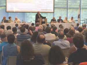 Kinder Morgan representatives present at a public meeting at Greenfield Community College on July 24, 2014