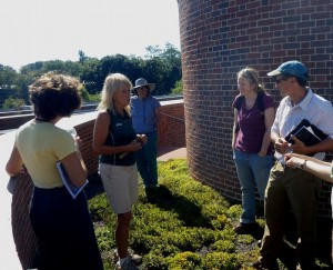 Denise Dwelley of the Deerfield Academy Grounds Department discusses the green roof at the Koch Center for Science, Math, & Technology with participants on the Franklin County LID Field Trip.