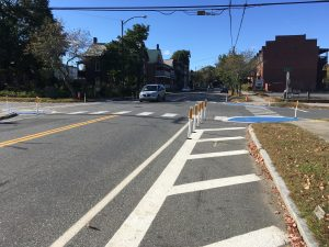 A photo to show the delineators installed to narrow the intersection and create more space for crossing pedestrians on Third Street.