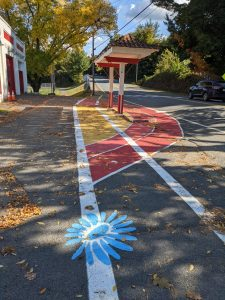To show the newly painted sidewalk area on Third Street in Turners Falls